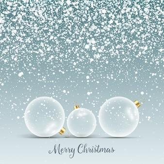 Fondo de navidad con bolas de cristal en la nieve