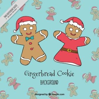 Fondo de navidad con pareja de galletas de jengibre