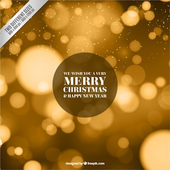 Fondo de navidad dorado en estilo difuminado