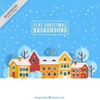 Fondo de navidad plano con un pueblo nevado