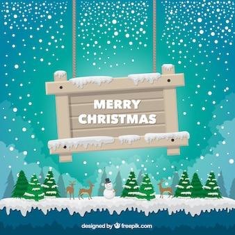 Fondo de paisaje con un cartel de feliz navidad