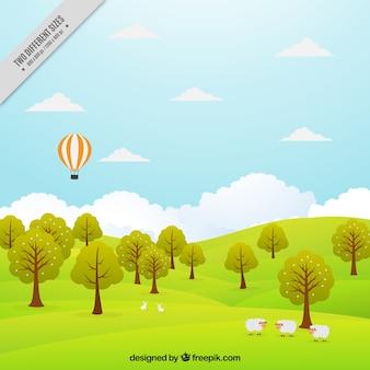 Fondo de paisaje de pradera con árboles y globo aerostático