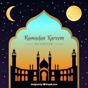 Fondo de ramadan kareem con mezquita al atardecer