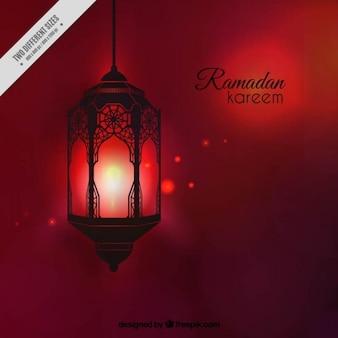Fondo de ramadan rojo con farol iluminado