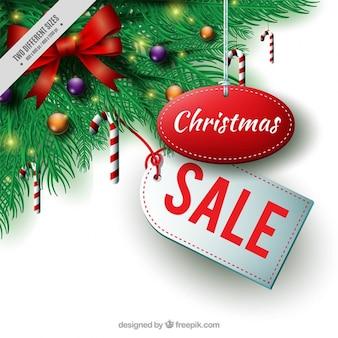 Fondo de rebajas navideñas con decoración de abeto