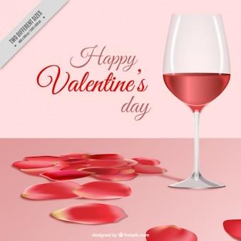 Fondo de san valentín bonito con pétalos y copa de vino