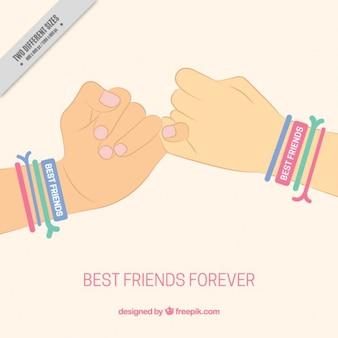 Fondo de símbolo de amistad con manos y pulseras de colores