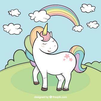 Fondo de unicornio en un paisaje dibujado a mano
