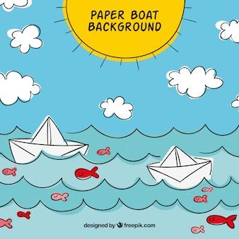 Fondo de verano con barcos de papel en el mar