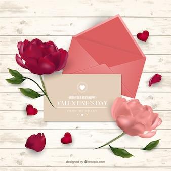 Fondo del día de san valentín con tarjeta y flores en estilo realista