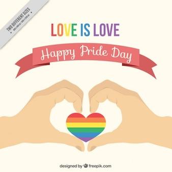 Fondo del día del orgullo de manos con un corazón colorido