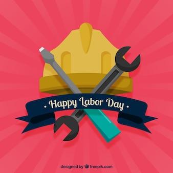 Fondo del día del trabajador con herramientas y casco