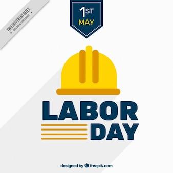 Fondo del día del trabajo con casco amarillo