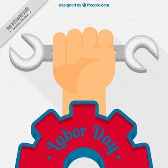 Fondo del día del trabajo de mano con llave inglesa