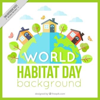 Fondo del día mundial del hábitat con casas en diseño plano