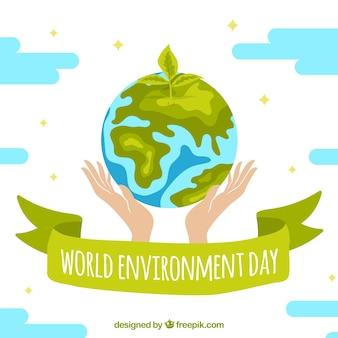 Fondo del día mundial del medioambiente con dos manos sujetando el globo terráqueo
