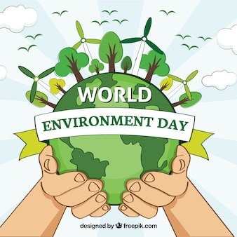 Fondo del día mundial del medioambiente con manos y molinos eólicos