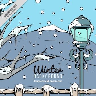 Fondo dibujado a mano de paisaje de invierno con farola