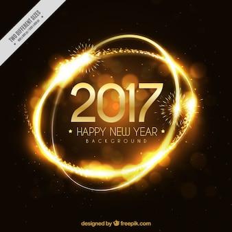 Fondo elegante de anillos dorados de año nuevo 2017