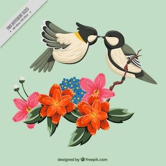 Fondo floral con pájaros bonitos besándose