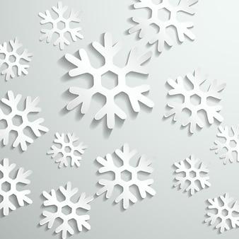 Fondo gris con copos de nieve blancos