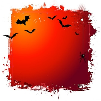 Fondo grunge de halloween con murciélagos y tela de araña colgando