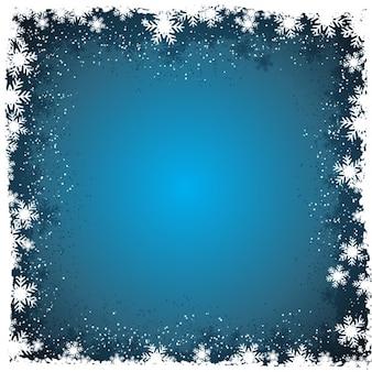 Fondo invernal con copos de nieve en los bordes
