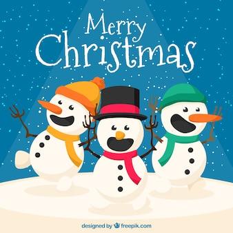 Fondo navideño con tres muñecos de nieve sonrientes