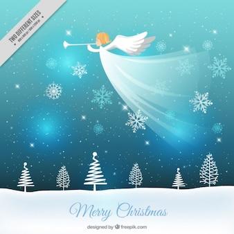 Fondo navideño de paisaje nevado y ángel tocando la trompeta