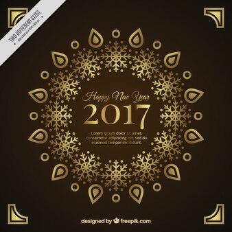 Fondo ornamental dorado de año nuevo 2017