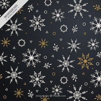 Fondo oscuro con variedad de copos de nieve
