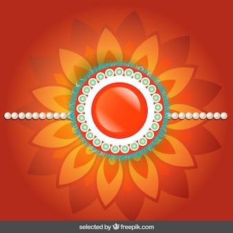Fondo Rakhi con joya floral naranja