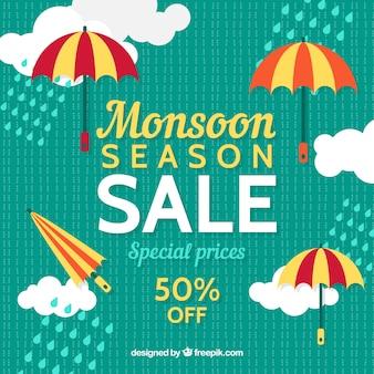 Fondo retro de rebajas de monzón con nubes y paraguas en diseño plano