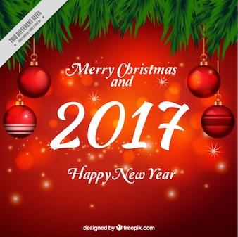 Fondo rojo de navidad con bolas y efecto bokeh