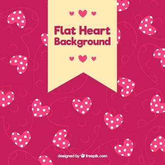 Fondo rosa de corazones con lunares