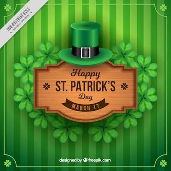 Fondo verde de rayas con cartel de madera del día de san patricio