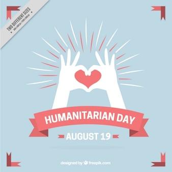 Fondo vintage del día humanitario con manos y corazón
