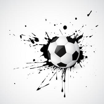 Fútbol colocado en un diseño grunge