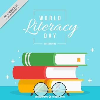 Gafas y libros para el fondo del día de la alfabetización
