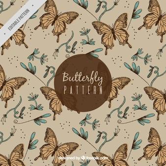 Genial patrón de mariposas y flores en estilo vintage