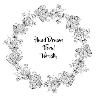 Guirnalda floral blanco y negro dibujada mano