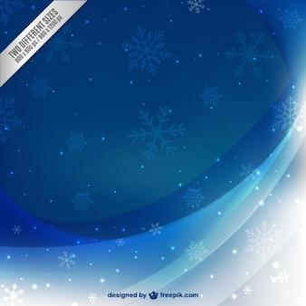 Hermoso fondo de invierno con copos de nieve