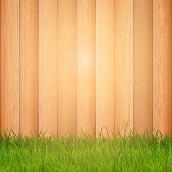 Hierba verde sobre un fondo de madera