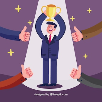 Hombre de negocios levantando un trofeo