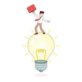 Hombre de negocios que monta la lámpara brillante de la idea