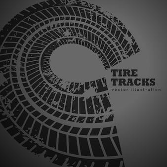 Huellas de neumáticos circulares sobre fondo oscuro