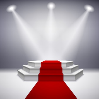 Iluminado podio de la etapa con alfombra roja
