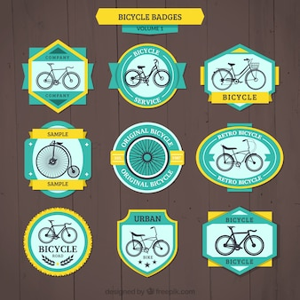 Insignias de bicicleta vintage con detalles amarillos