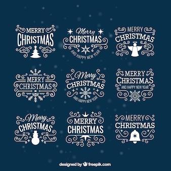 Insignias de la Navidad blancas
