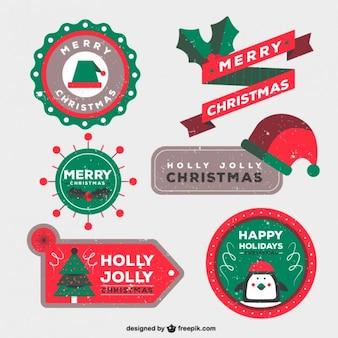 Insignias de navidad en estilo estampado